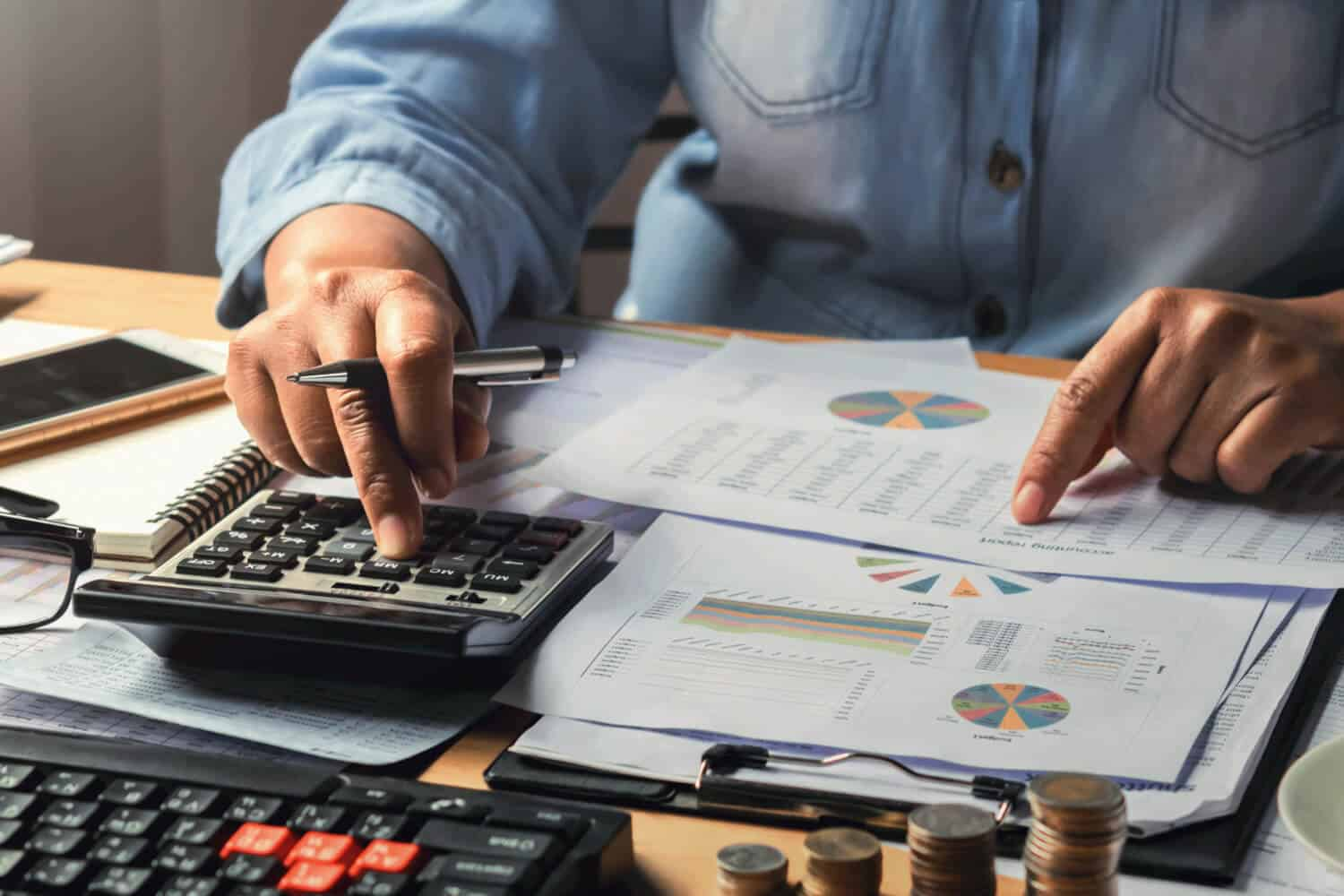 accounting-concept-businesswoman-working-using-calculator-with-money-stack-office-1[1]