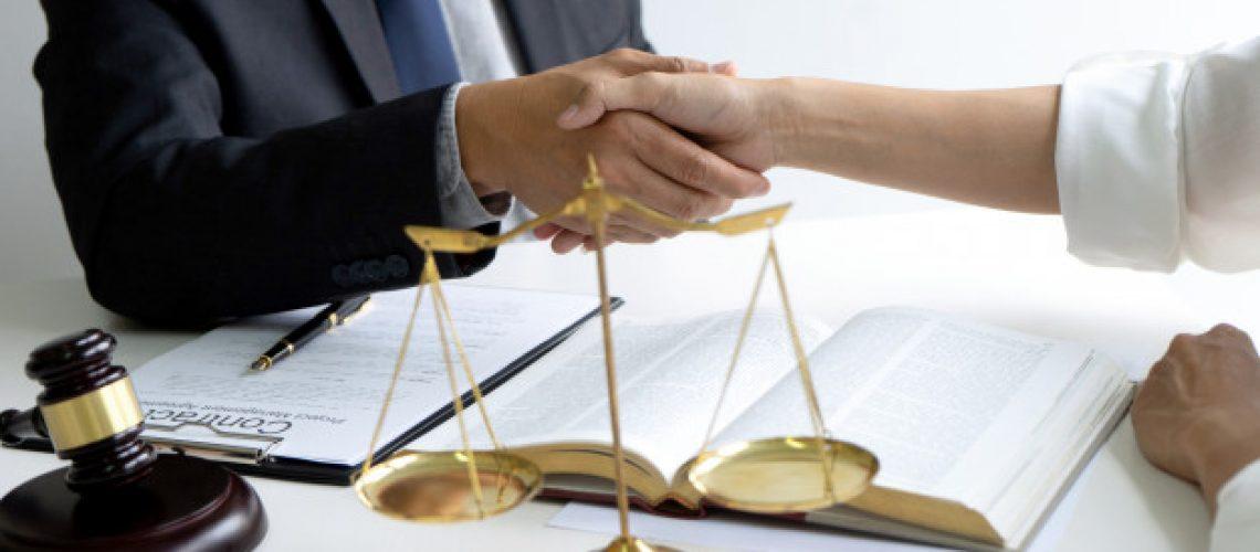 lawyer-judge-with-gavel-balance-handshake_93025-219